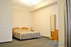 Спальня в номере Де Люкс
