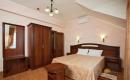 Спальня в 2-местном 2-комнатном Люксе