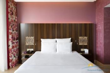 2-местный Swiss Advantage room зона спальная.jpg